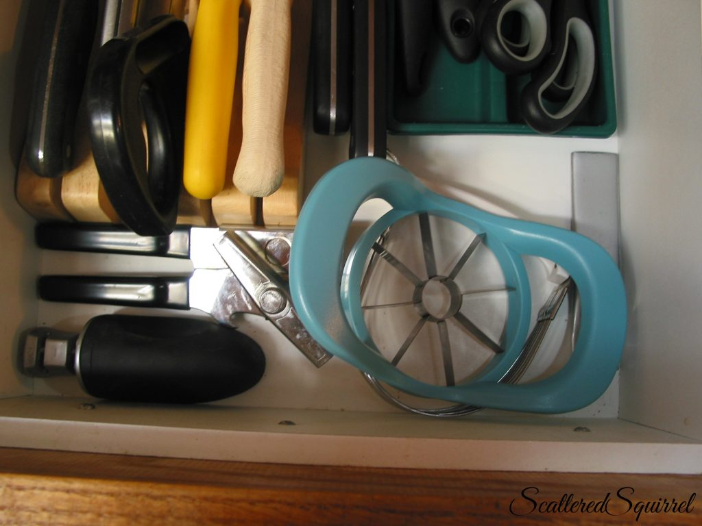 a few spare kitchen tools neatly contained in the front of the drawer