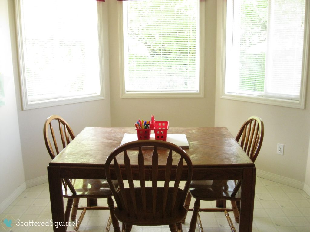 Clean and simple breakfast nook, with coloring supplies laid out on the table. ScatteredSquirrel.com