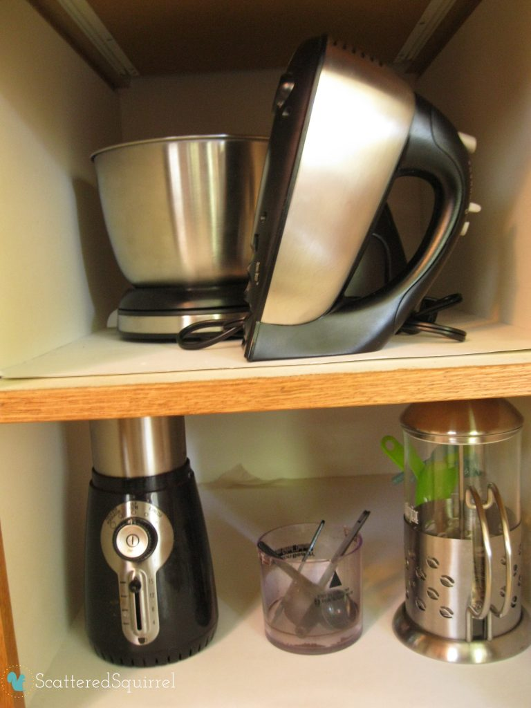 Store smaller, not often used appliances in a kitchen cupboard to keep your counter tops clutter free. ScatteredSquirrel.com
