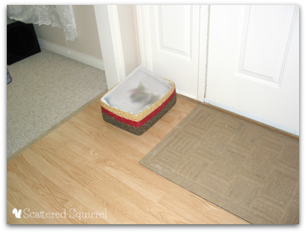 Work with a habit, instead of against it, by using a basket to help control the mess. |ScatteredSquirrel.com
