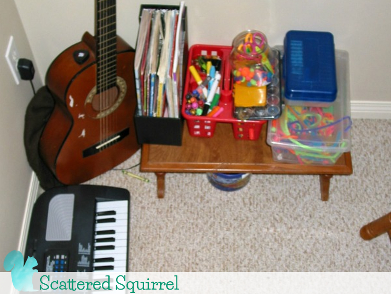 Arts and crafts supplies waiting for a new home after being displaced from the family room.