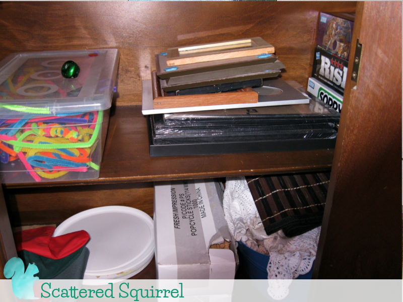 Spare Picture Frames And Craft Supplies Neatly Contained In The Buffet