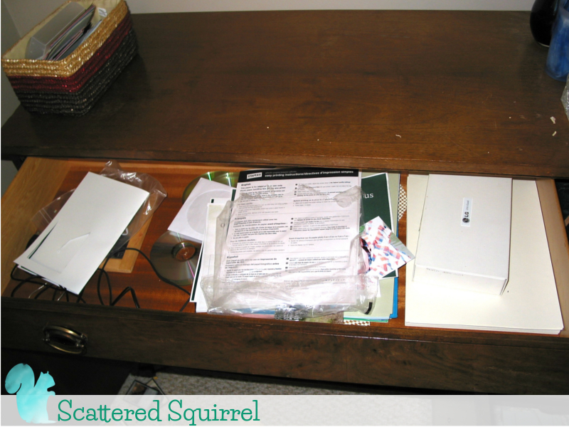 Messy drawer of paper and more office supplies that never made the transition into my new office space.