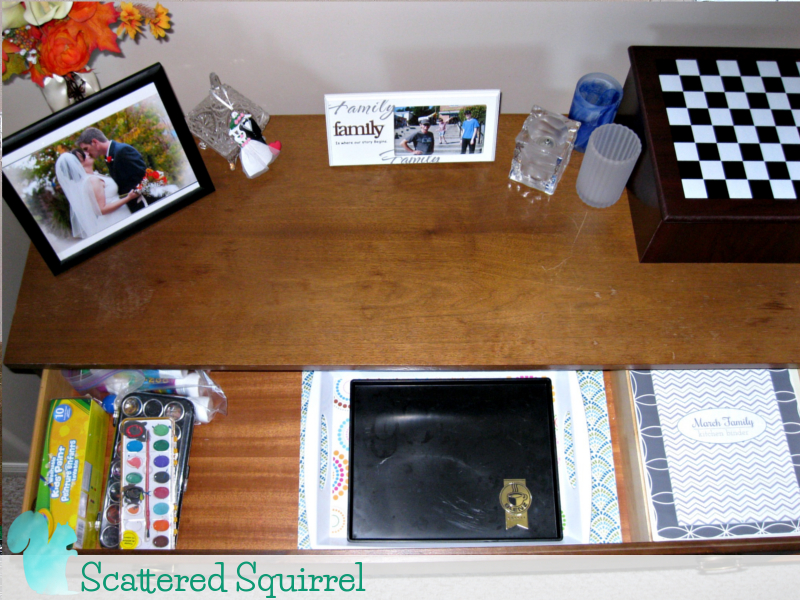 Top drawer of the buffet is all organized, paint supplies on the left, serving trays and spare placemats in the middle, and our kitchen binder on the right.